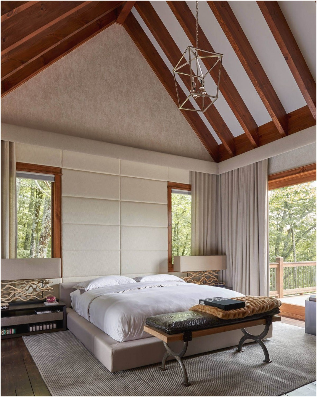 Modern bedroom with a platform bed and vaulted ceiling