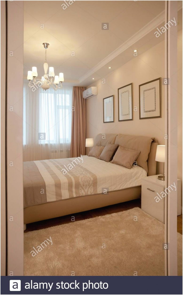 epmty minimalistic interior background bedroom of modern apartment with big windows double bed lights on nobody with copy space vertical 2B1TBF1