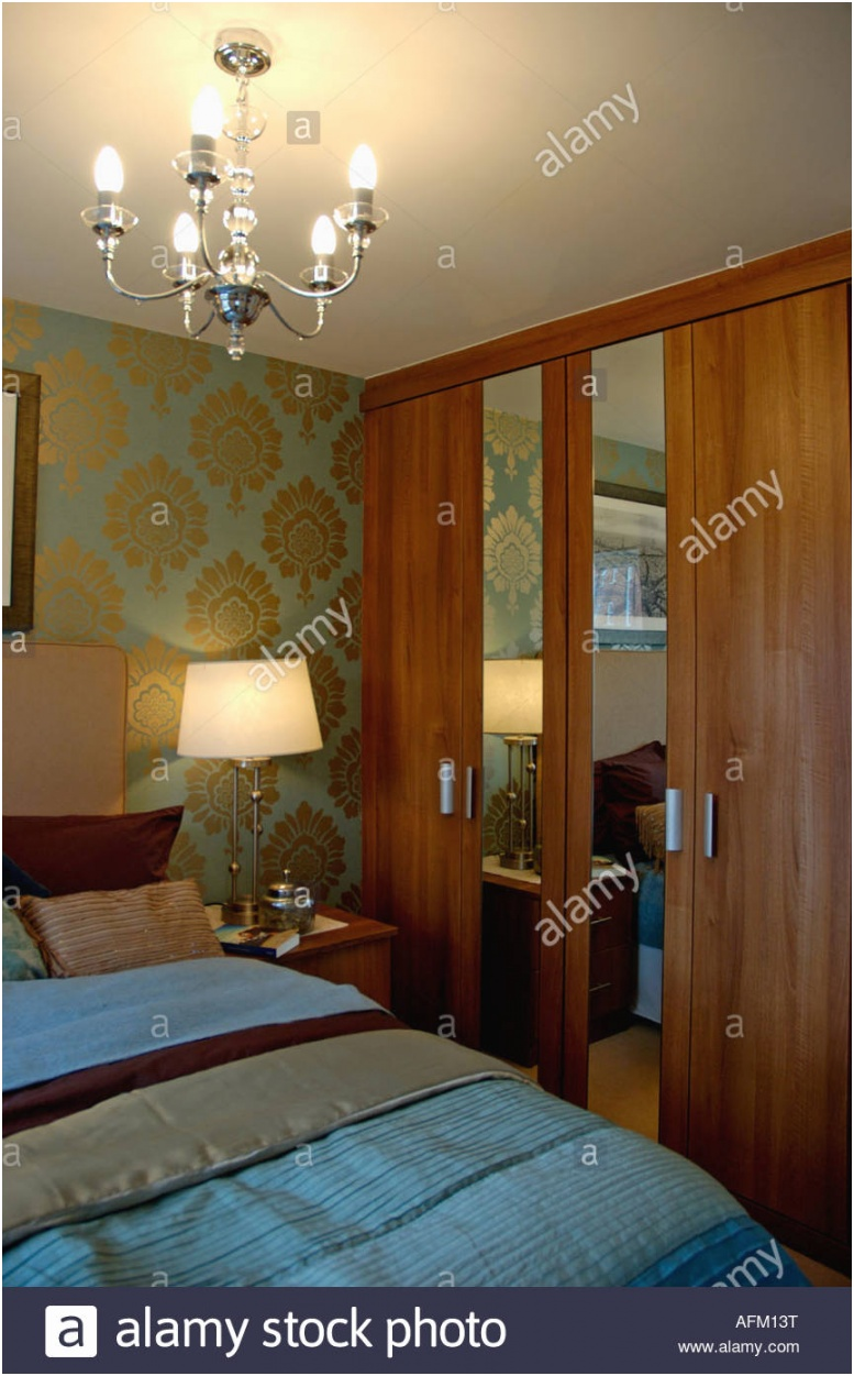 wallpaper and fitted cupboards with mirror in modern bedroom with AFM13T