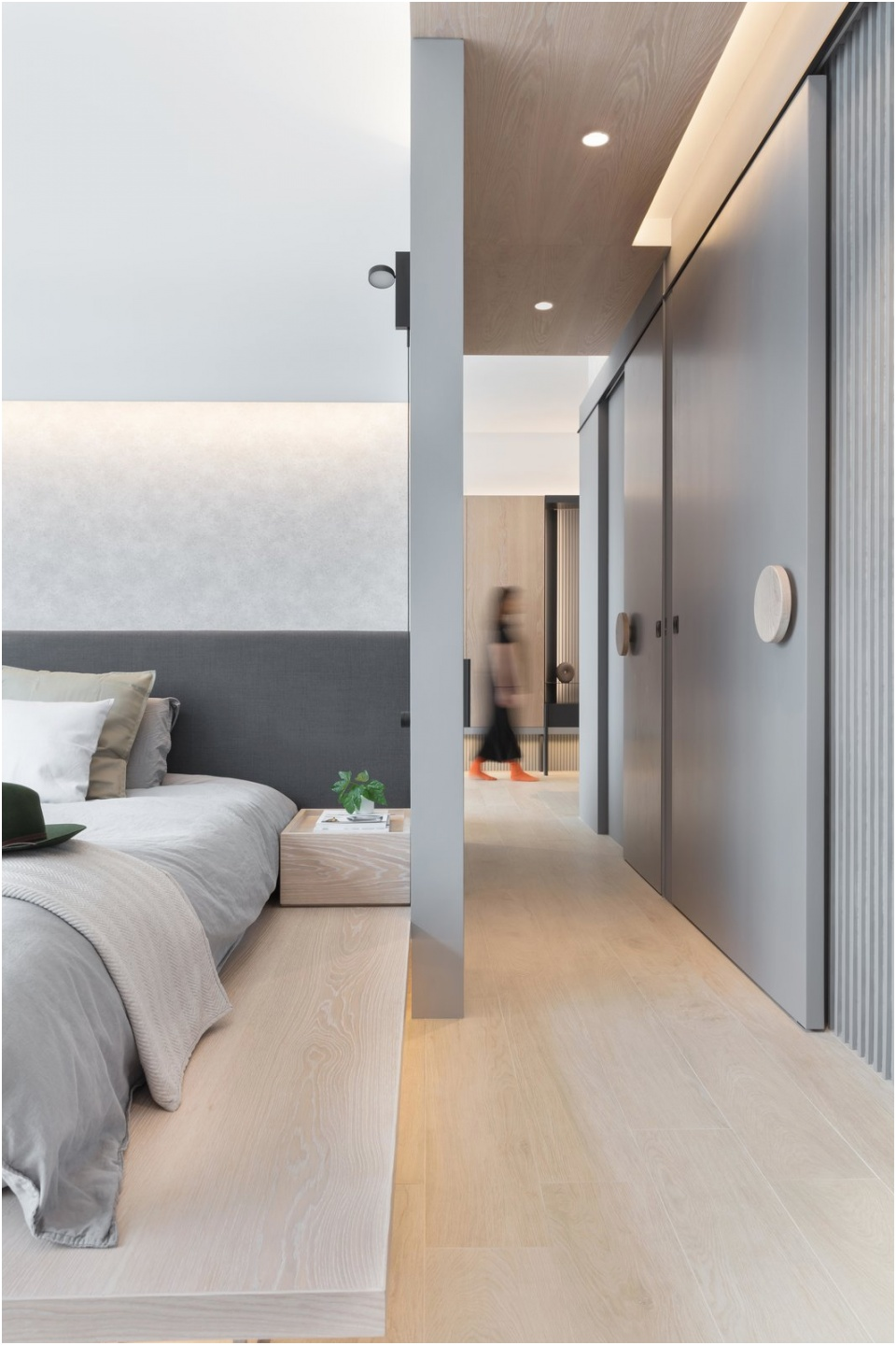 the bedroom and corridor at the southern side of hong kong we have recently designed an apartment facing the aberdeen harbour with a beautiful mountain view the apartment is designed to lengthen the horizontal experience with long timber cabinet wall and