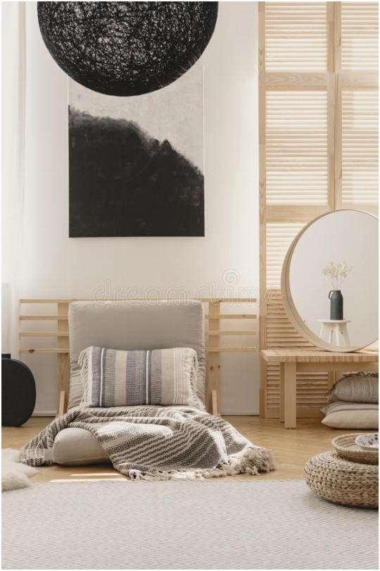 abstract black white painting wall bright bedroom interior futon bed mirror bedside table