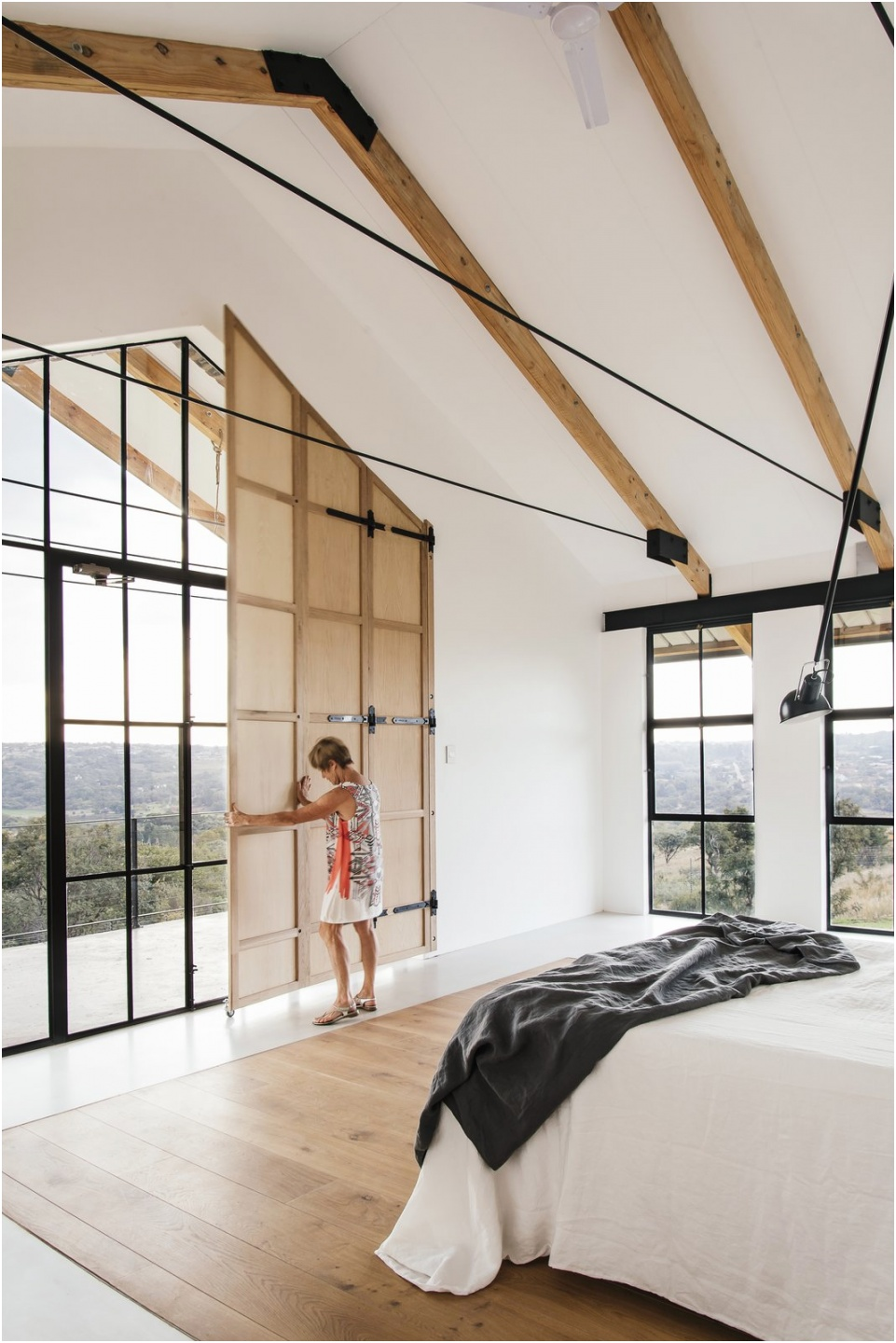 the master bedroom is located on the western side and has a balcony that is well set up for enjoying brilliant sunset views one of our favorite master bedroom lighting ideas for a vaulted ceiling is to suspend task lighting from the rafters seen here in t