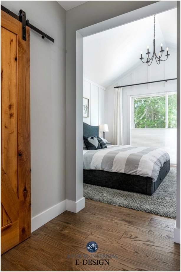 Master Bedroom white board and batten paint colour vaulted ceiling chandelier wood barn door and white oak flooring Stonington Gray Kylie M Interiors Edesign online paint color advice blog 683x1024