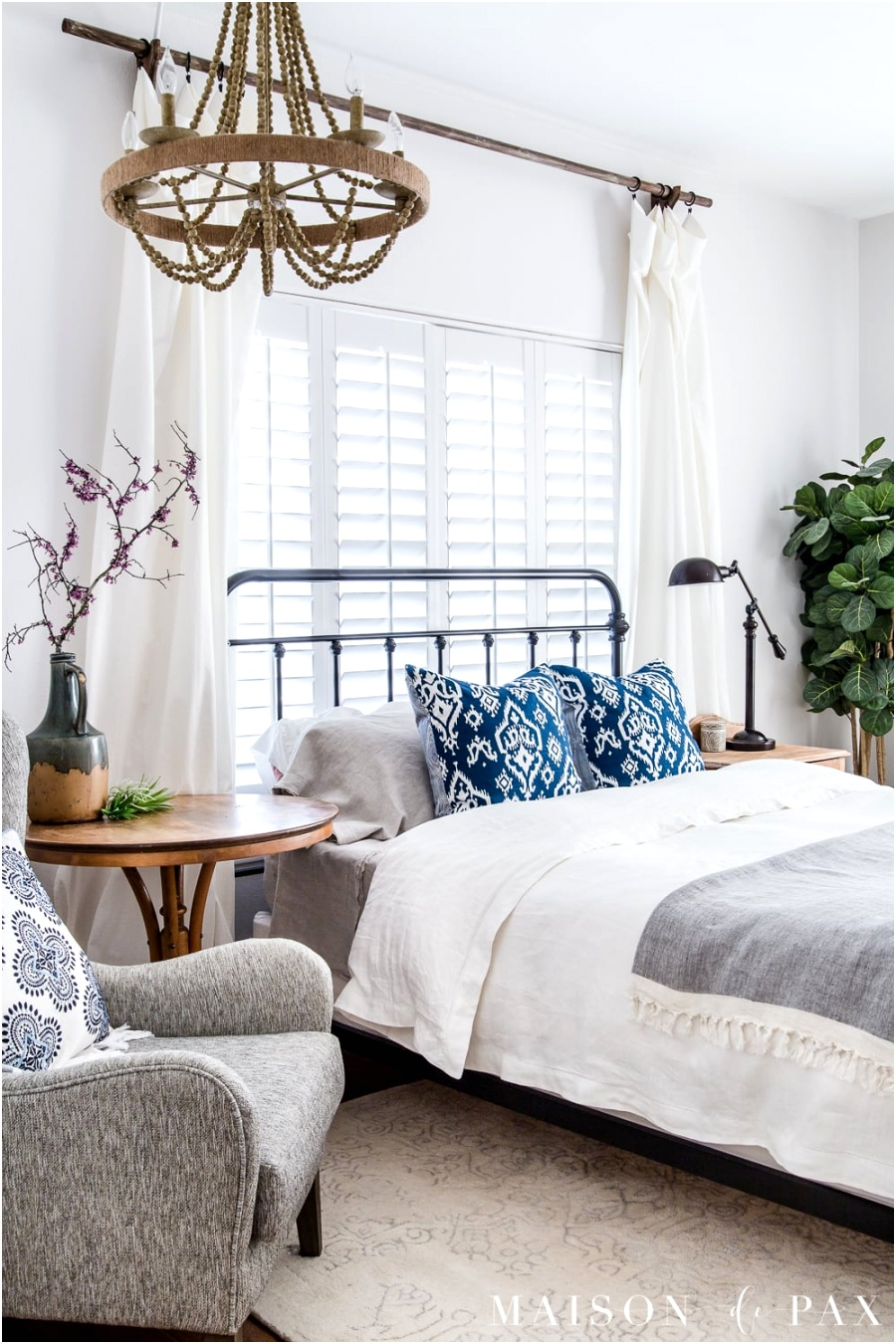 White modern farmhouse master bedroom decorated for spring 4
