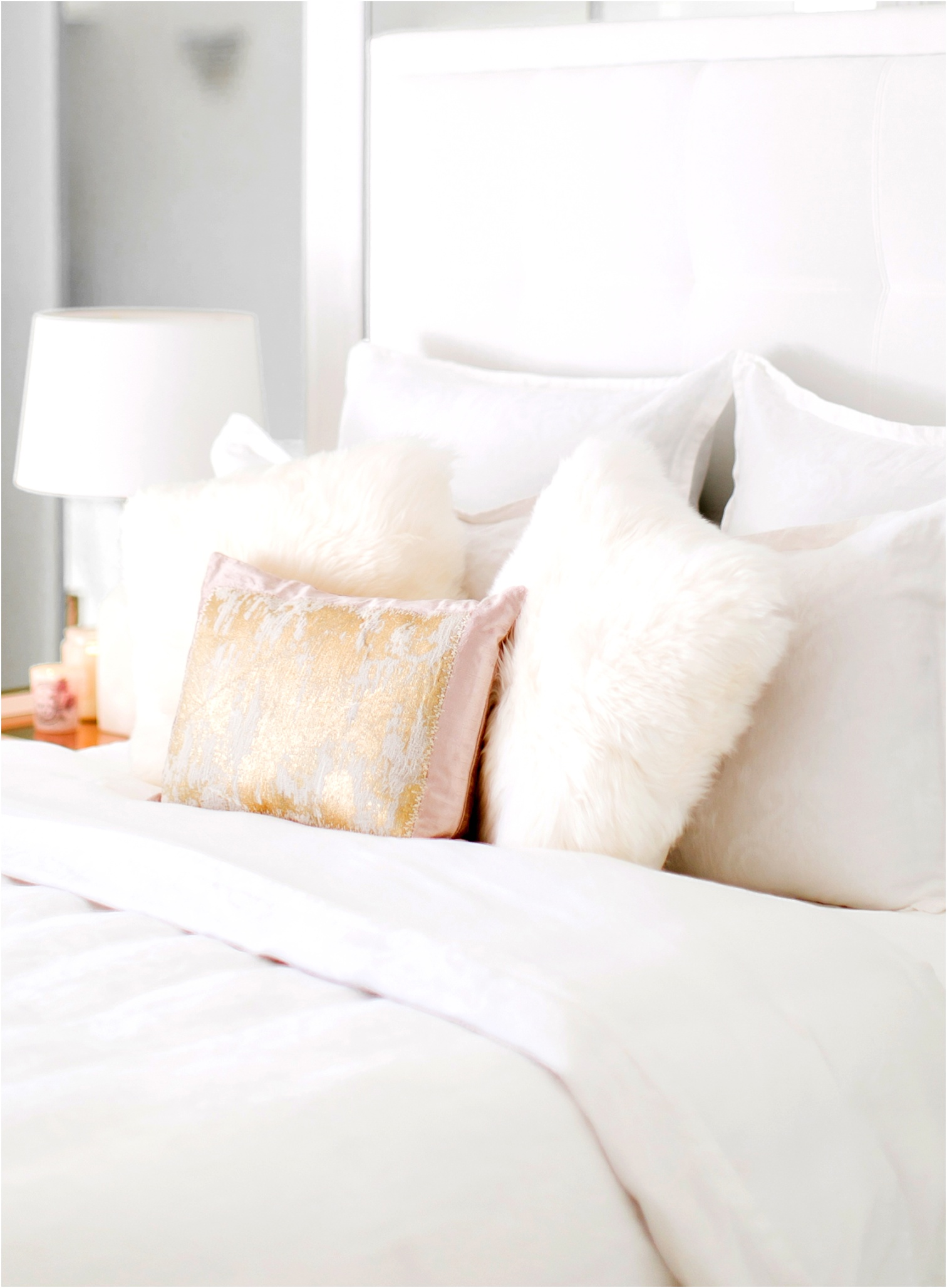 Sydne Style shares bedroom decorating ideas with ugg fluffy pillow and blush gold decorative pillows