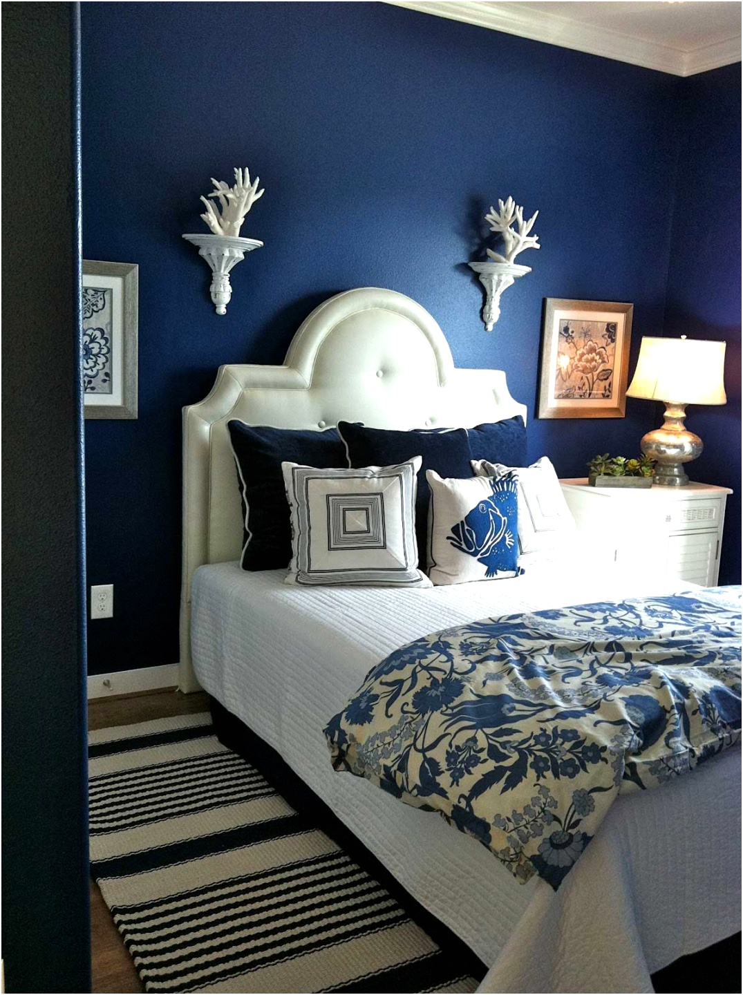 Smaller bedroom with navy blue walls