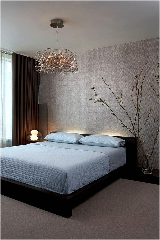 Lighting and minimalism give this contemporary bedroom a zen inspired look