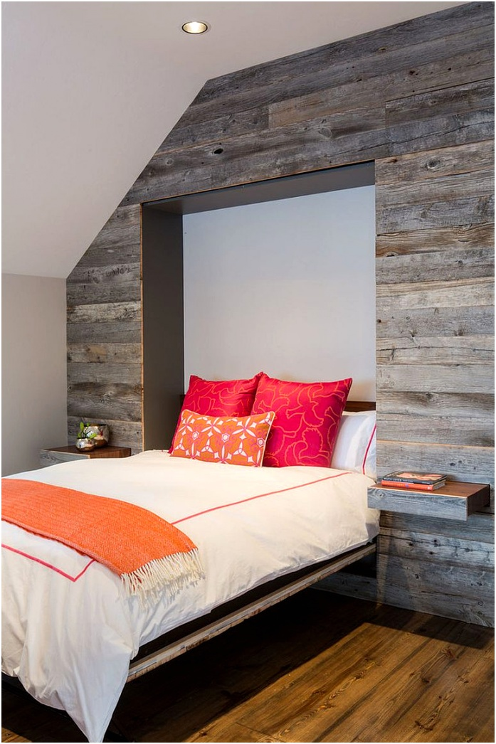 Murphy bed and pull out nightstands disappear into the reclaimed wood wall when not needed