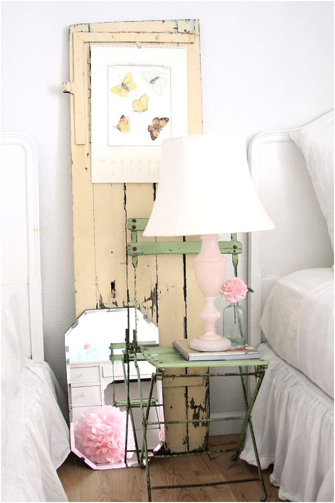 Old chair vintage door and lovely lamp make the bedside area a shabby chic delight