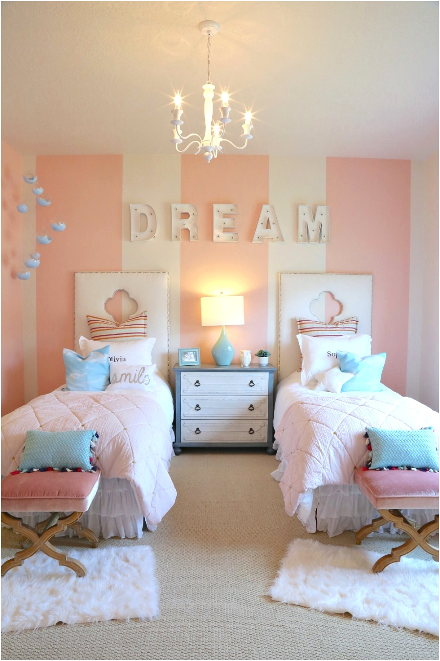Girls twin bedroom with striped walls