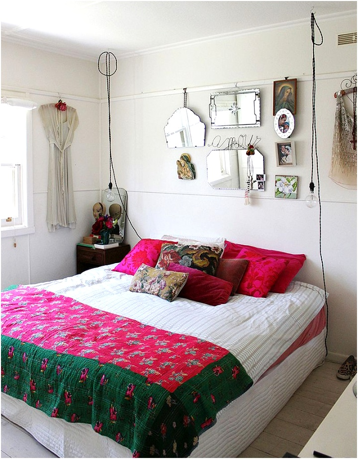 Wire pendants lights bright accent pillows and colourful bedding shape the shabby chic bedroom