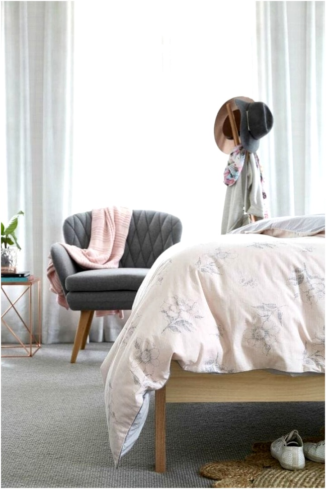 pink and grey girls bedroom ideas with grey armchair and blonde timber bed frame with sheer curtains